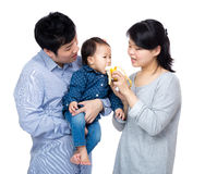 Mother give banana to daughter in asian family Stock Images