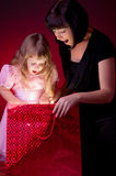 Mother give gift to her daughter Stock Photo