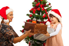 Mother give gifts to her daughter Royalty Free Stock Photos