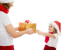 Mother gives a Christmas gift to his daughter Royalty Free Stock Images