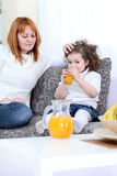Mother gives daughter juice Royalty Free Stock Photo