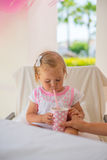 Mother Gives Her Daughter Drink Stock Photography