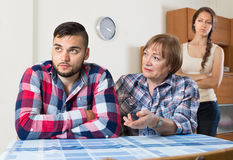 Mother gives solace to young son Stock Photos