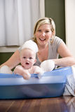 Mother giving baby a bath Royalty Free Stock Photography