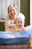 Mother giving baby a bath Royalty Free Stock Images