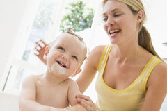 Mother giving baby bubble bath Royalty Free Stock Image