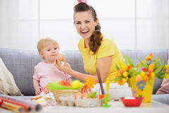 Mother giving baby Easter egg Stock Photo