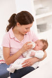 Mother Giving Bottle Baby Boy At Home Royalty Free Stock Images