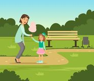 Mother giving cotton candy to her daughter while walking in summer park outside, family leisure vector illustration. Web banner Stock Photography