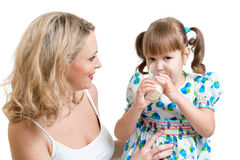 Mother giving dairy drink to kid Royalty Free Stock Images