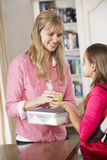 Mother Giving Daughter Healthy Lunchbox In Kitchen Stock Photography