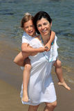 Mother giving daughter piggyback Stock Photography
