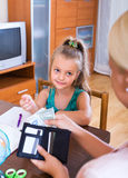Mother giving daughter pocket money Stock Images