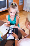 Mother giving daughter pocket money Stock Image
