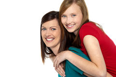Mother giving daughter ride on back Stock Photography