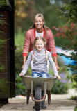 Mother Giving Daughter Ride In Wheelbarrow Royalty Free Stock Image