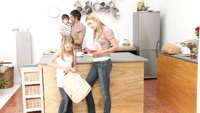 Mother giving girl the school lunch in the kitchen Royalty Free Stock Image
