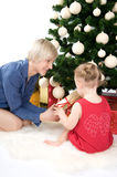 Mother is giving a gold gift to little baby Royalty Free Stock Images