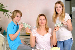 Mother giving her children pocket money Royalty Free Stock Photos