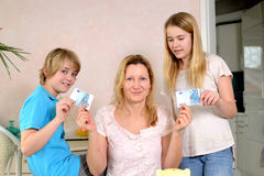 Mother giving her children pocket money Stock Photos