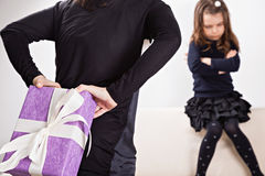 Mother giving her daughter a gift Royalty Free Stock Photography