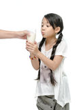 Mother  giving her daughter a glass of milk Royalty Free Stock Photos