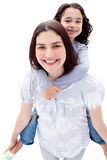 Mother giving her daughter piggyback ride Royalty Free Stock Images