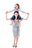 A mother giving her daughter piggyback ride Royalty Free Stock Photography