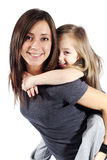 Mother giving her daughter a piggyback ride Stock Photo