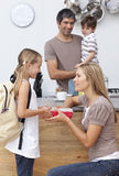 Mother giving her daughter the school lunch Royalty Free Stock Images