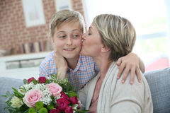 Mother giving kiss to her son Royalty Free Stock Images