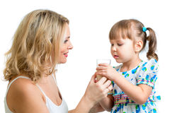 Mother giving milk drink to kid Stock Image