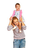 Mother giving piggy back to girl Stock Photo