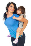 Mother giving piggy back to her daughter Royalty Free Stock Photography