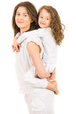 Mother giving piggyback ride Royalty Free Stock Photos