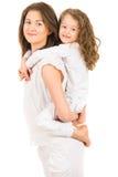 Mother giving piggyback ride Royalty Free Stock Photos