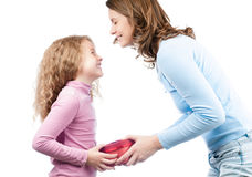 Mother giving present to daughter. Stock Photo