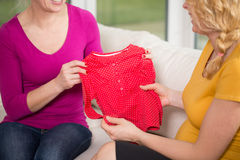 Mother giving present to daughter Royalty Free Stock Photos