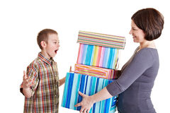 Mother giving presents to her son. Surprised son receiving many gifts from his mother Stock Photography