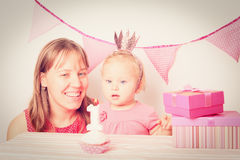 Mother giving presents to little daughter at Stock Photo