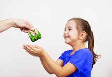 Mother giving the purse to a little girl Royalty Free Stock Photos