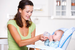 Free Mother Giving The Water To  Baby Royalty Free Stock Image - 18130086
