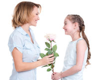 Mother giving the white rose to her little   daughter Stock Images