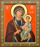 Mother of God Jesus Christ. The Icon a Mother of God (Mary) and child (Jesus Christ) on gilding wood Royalty Free Stock Photography