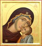 Mother of God Jesus Christ. The Icon a Mother of God (Mary) and child (Jesus Christ) on gilding wood Stock Photos