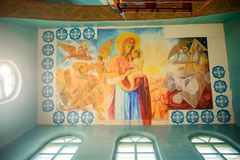 Mother of God rise behind. Icon in the church. stock photo