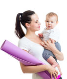 Mother going to do fitness exercises with baby Stock Photo