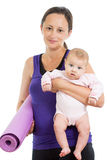 Mother going to do fitness exercises with her baby Royalty Free Stock Photo
