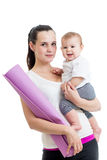 Mother going to do fitness exercises with her baby Stock Image