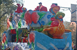 Mother Goose on the Front of Mardi Gras Float. Parade floats in the various Mardi Gras parades in New Orleans, are double decker. People are on both levels royalty free stock images